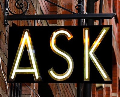 A neon sign saying ASK
